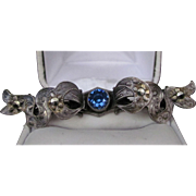 Antique Stamped Sterling Marcasite Bar Brooch Pin with a Gorgeous Blue Glass Cabochon in the .