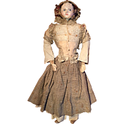 SOLD An early paper mache doll type Pauline