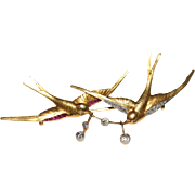 Exceptional quality Antique Edwardian 18 carat gold, diamond and synthetic ruby swallow love .