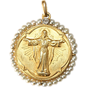 Antique Edwardian 18 carat yellow gold and platinum diamond and pearl Christ medallion pendant