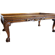 An American carved walnut coffee table in the Chippendale style