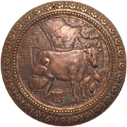 Antique Bronze Raised Relief Plaque Depicting Country Scene of Farmer Milking a Dairy Cow and