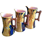 Majolica Sheaf of Wheat Graduated Pitchers with Cobalt Blue Ground and Pink Interior