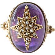 SALE A cabochon amethyst 9ct gold mounted ring, 20th. century.