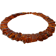 SALE A graduated polished amber necklace, 1970 - 1980.