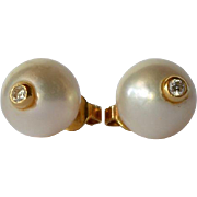 SALE Gold (18ct) mounted pearl (cultured) earrings with a brilliant diamond apiece, 1985.