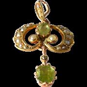 SALE An Edwardian , 1910, gold ( 15ct ) peridot set pendant.