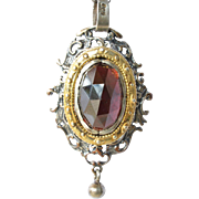 SALE Silver ( 800 standard ) and silver gilt mounted garnet set pendant on chain, 1960 - 1980.