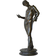 SALE A patinated bronze figure of Narcissus, Italian, late 19th century.