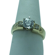 Lady's 14K yellow gold diamond engagement ring with Cubic zirconium center