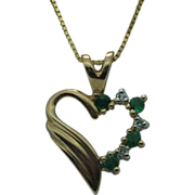 Lady's 14Ky diamond and emerald heart pendant and chain