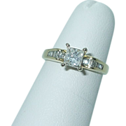 Lady's 14K gold princess and baguette engagement ring