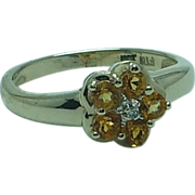 Lady's 10K yellow gold citrine and diamond ring
