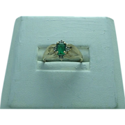 Lady's 10K yellow gold created emerald and diamond ring