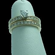 Lady's 14K yellow gold diamond wedding and engagement set