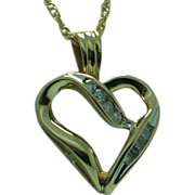Lady's diamond 10K heart on  18 inch gold filled chain