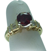 Lady's 18K yellow gold synthetic ruby and diamond ring
