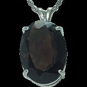 Lady's  25 x 18mm oval smokey quartz sterling pendant