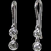 Antique Diamonds platinum dangling drop earrings estimated 1.00 carats. Diamonds circa 1910.
