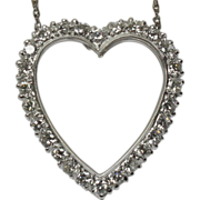 Diamonds and 14 karat white gold heart pendant with chain.