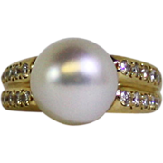 10.6 mm South Sea cultured Pearl, Diamonds, 14 karat yellow gold ring.