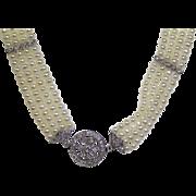 Diamonds, cultures saltwater pearls, 14 karat gold necklace.
