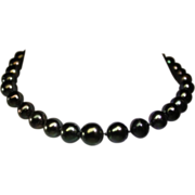 Cultured South Sea black pearls necklace.