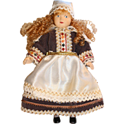 Bisque vintage national costume dressed small doll