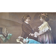 Vintage postcard with children playing doctor