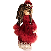 Porcelaine doll in velvet purple gown by Collectors Choice series Dandee