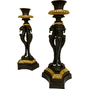 Pair of Empire candlesticks, griffons / chimera sculpture, patinated bronze and ormolu