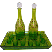 Baccarat : antique French green and gilt crystal liquor set.