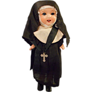 "8"" Bisque Nun Doll, All Original, open mouth and glass eyes."