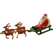 Vintage All Metal Santa on Sled with Reindeer