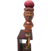 Hand Carved sculpted wooden woman's head with amusing face attached to a golden brass ...