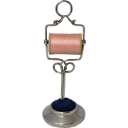 Sewing Spool KNAVE, thread dispenser stand with a Silver PIN CUSHION base.;Antique c1900's