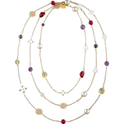 Long beaded necklace on a chain with gemstones: red spinel, amethyst, citrine quartz, mother o