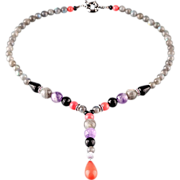 Necklace with pendant made of gemstones. Lilac, rose, grey and black palette