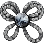 Black and white brooch made of imitation pearls in jewelry net