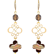 Long golden brown earrings with smoky quartz and mother of pearls four leaf clover. Dangling .