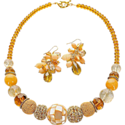 Set of collar necklace and bunch earrings in golden and yellow colors: mother-of-pearl ...