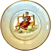 Two doll plates with reading woman design