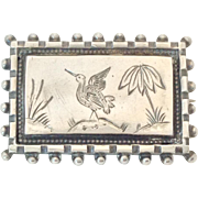 Victorian Aesthetic Movement sterling pin with bird and palm tree