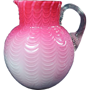 Phoenix Draped Cased Art Glass Peach Blow Water Pitcher w/ Reeded Handle