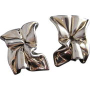 SOLD Divine Circa 1980 Modernist Vortex Twisted Bow Fine Sterling Silver Designer Earrings