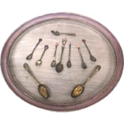 Oval display case with spoons