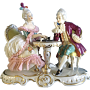 Vintage Alka Kunst Dresden Lace Porcelain Couple playing Chess Western Germany Figurine
