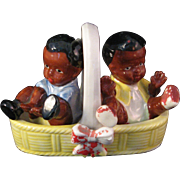 Vintage Porcelain Black Americana Boy and Girl sitting in Basket Salt & Pepper Shaker Set - ..