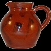 1992 Redware Bulbous Shaped Manganese Glazed Creamer by Lester Breininger
