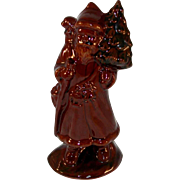 1988 Foltz Glazed and Sponge Decorated Redware Santa Clause Carrying Christmas Tree And Gift .